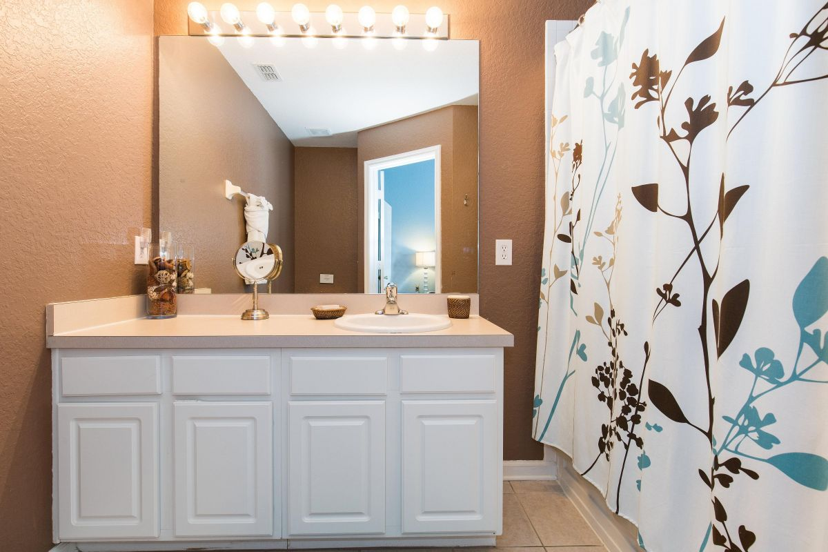 The master bathroom features a deep tub and shower.