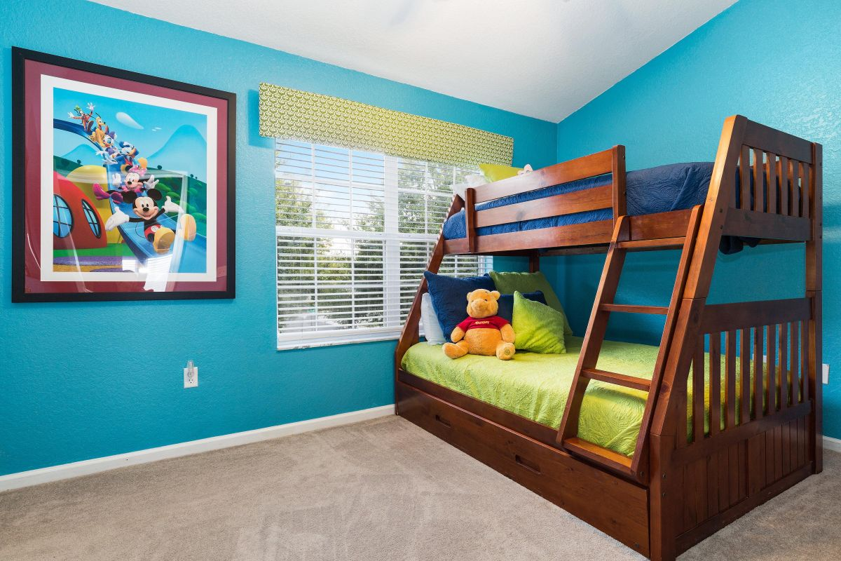 The third bedroom has a twin bed above a full-size bed with a twin trundle.