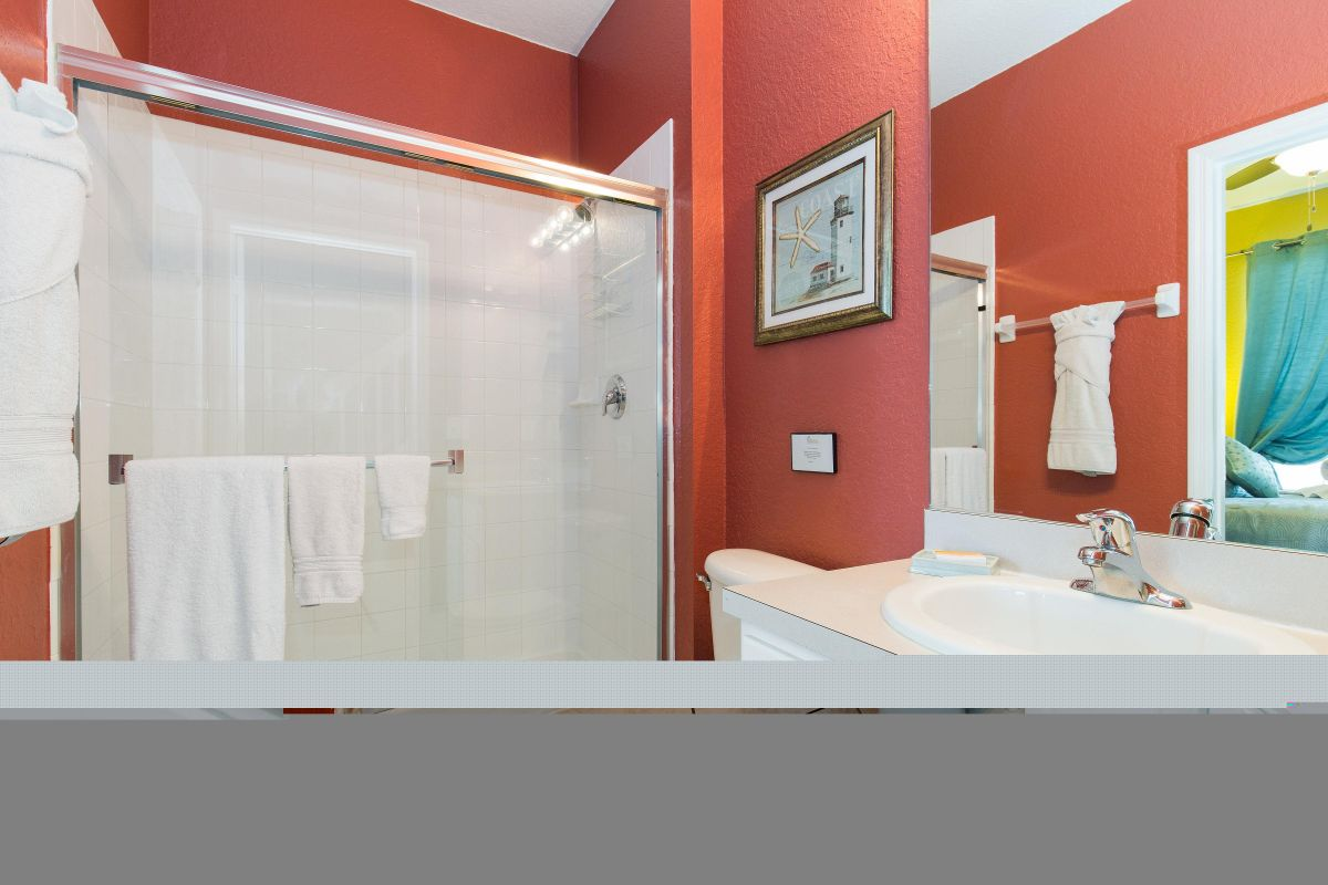 The downstairs bedroom has its own en suite bathroom with shower.