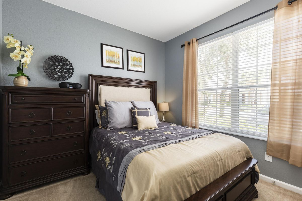 A Queen bedroom on the main floor has a large TV and books for your pleasure.