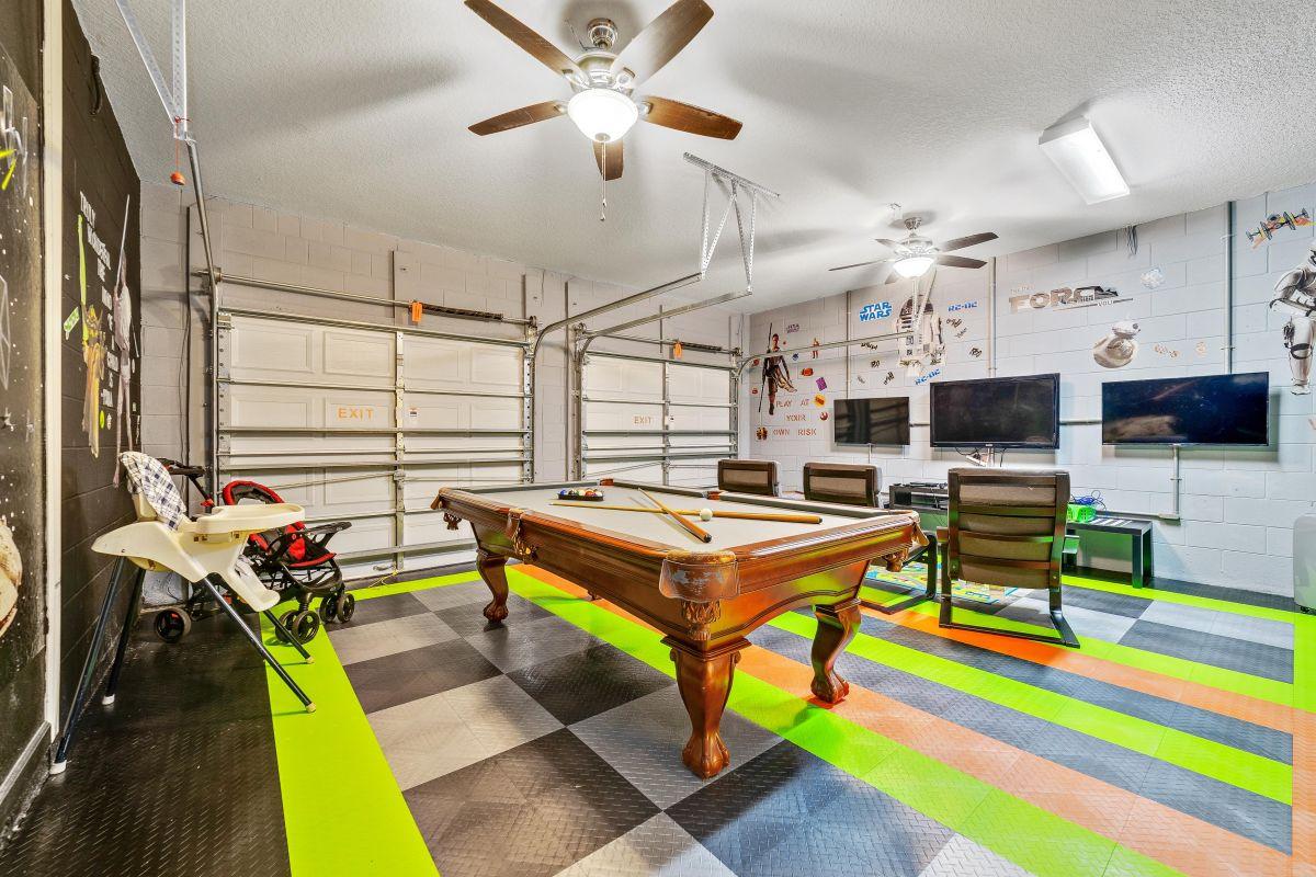 3 TV gaming center and pool table in Star Wars themed game room