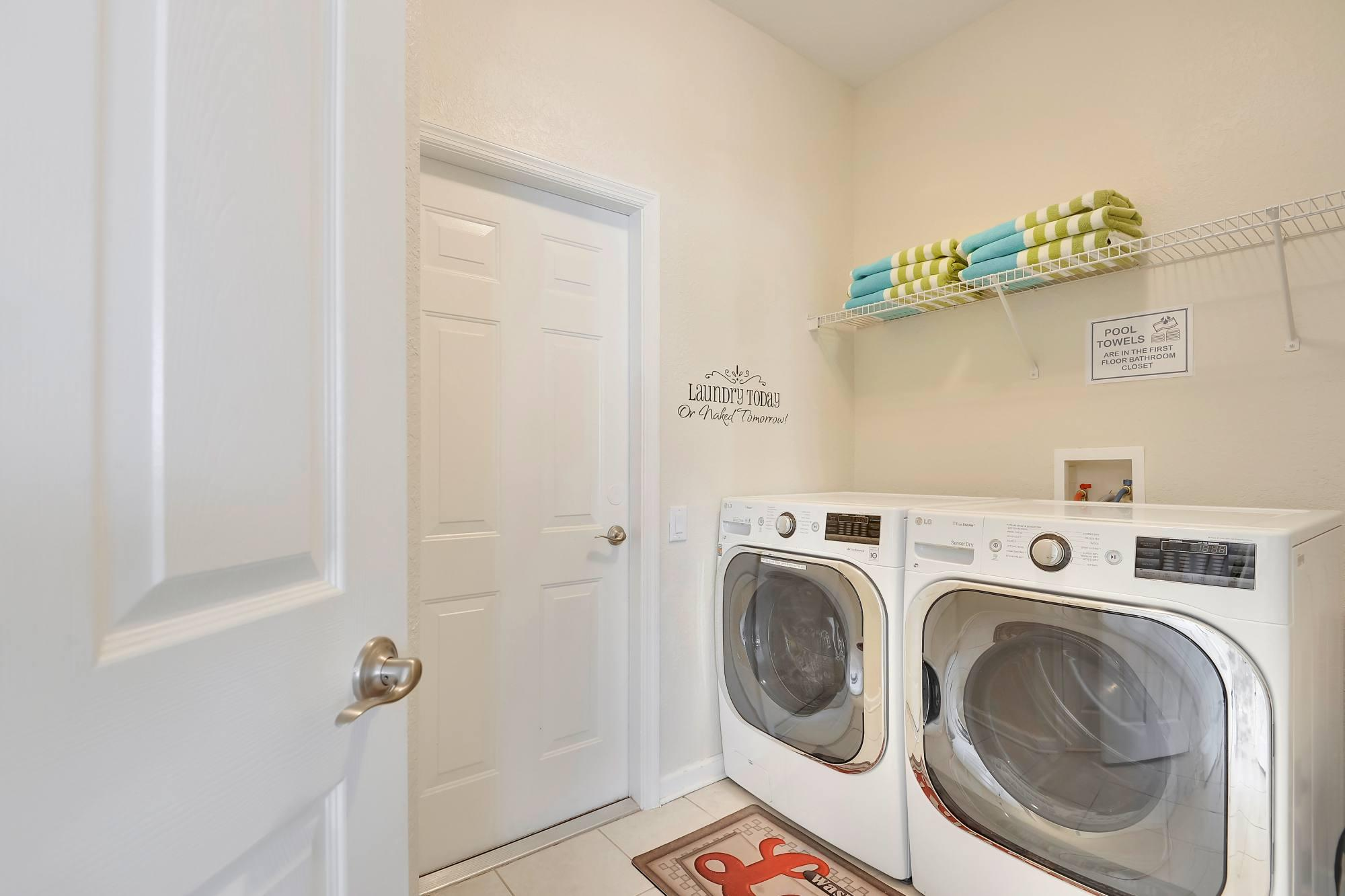 The laundry room with extra large washer and dryer