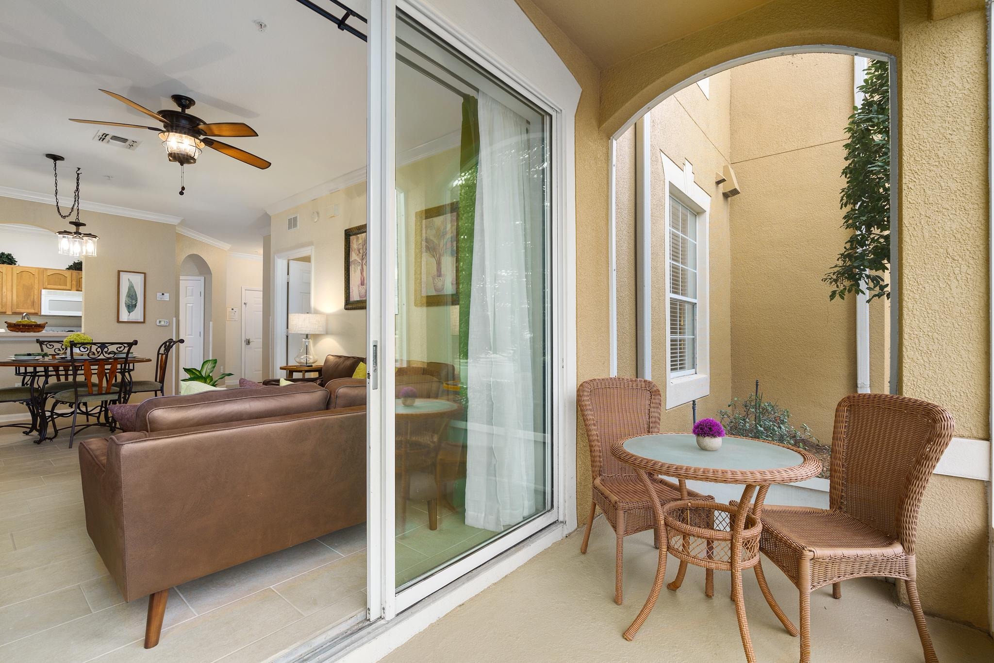 Private patio with ceiling fan