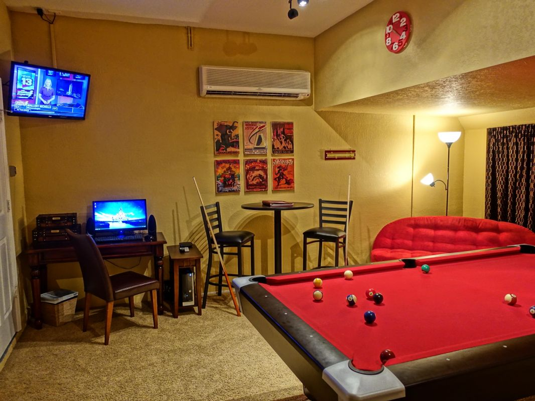Game Room Also Includes Flat Screen TV, New Computer and Seating Area