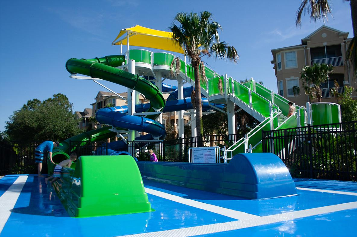 A water slide is available in the kids area near the pool.