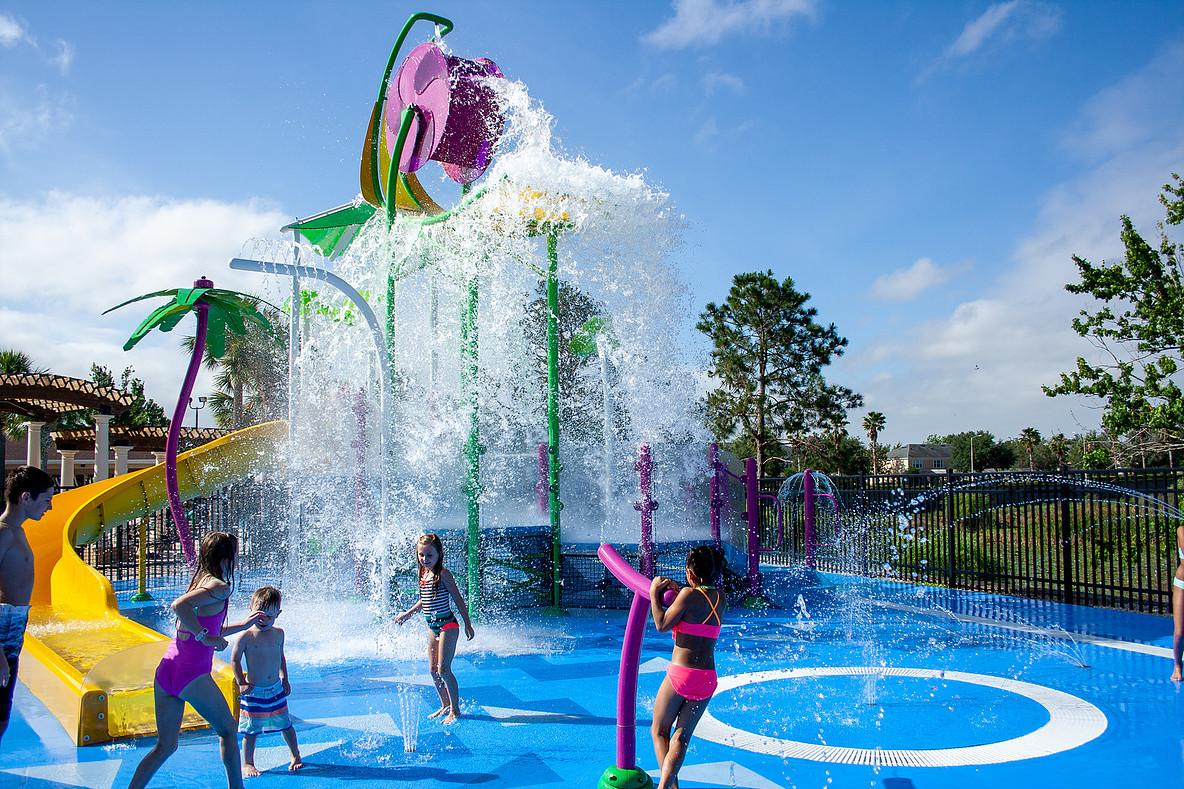 A splash pad is provided in the kids area by the pool.