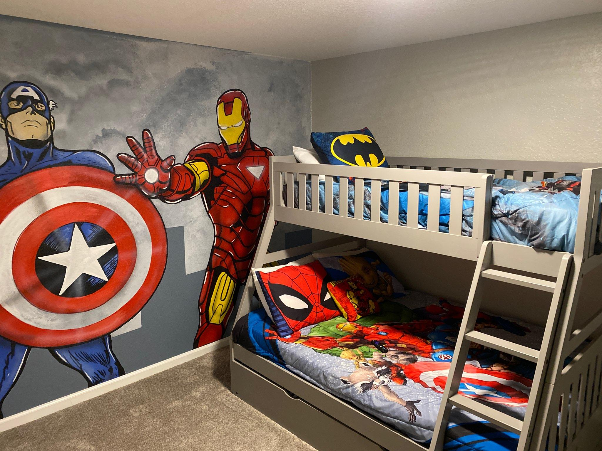 Avengers themed bedroom with a full bed and 2 twin beds.
