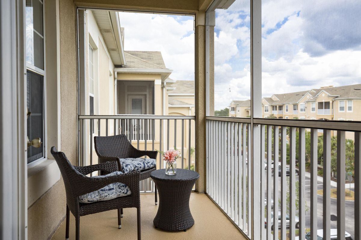 Sit back and relax in your private screened in patio