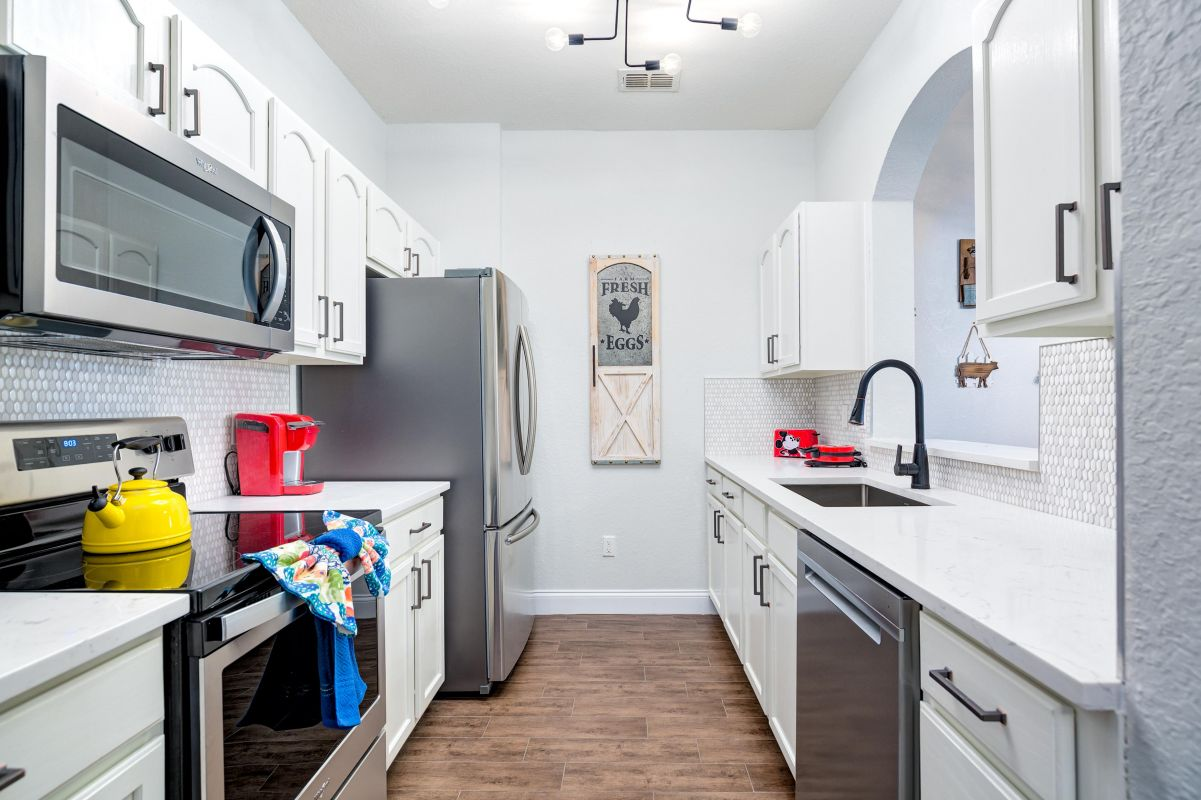Fully equipped kitchen with quartz counter tops and SS appliances