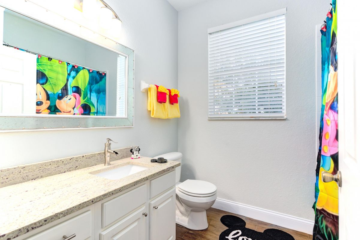 Disney themed full bath with upgraded fixtures and dual head shower/hand shower