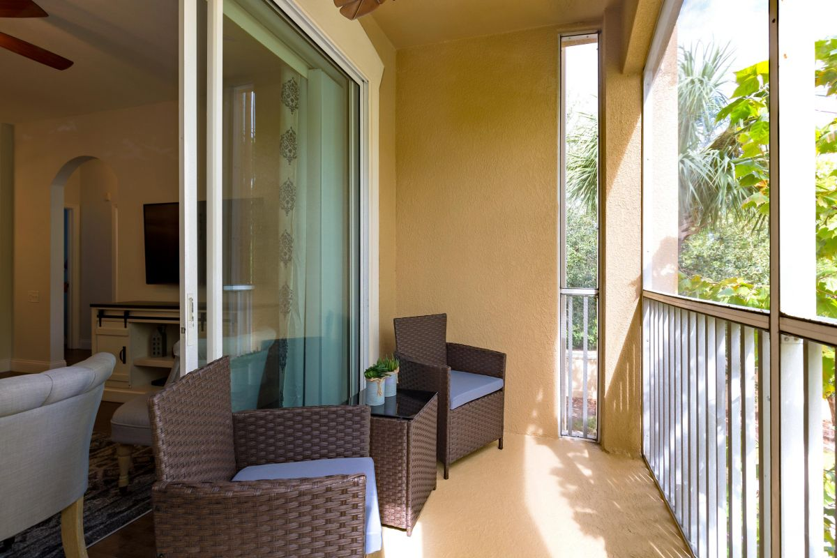 Screened in Patio with comfortable seating -  just off the living area.