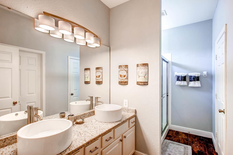 Upgraded  master bath with dual vanities, rain shower head & huge walk-in closet