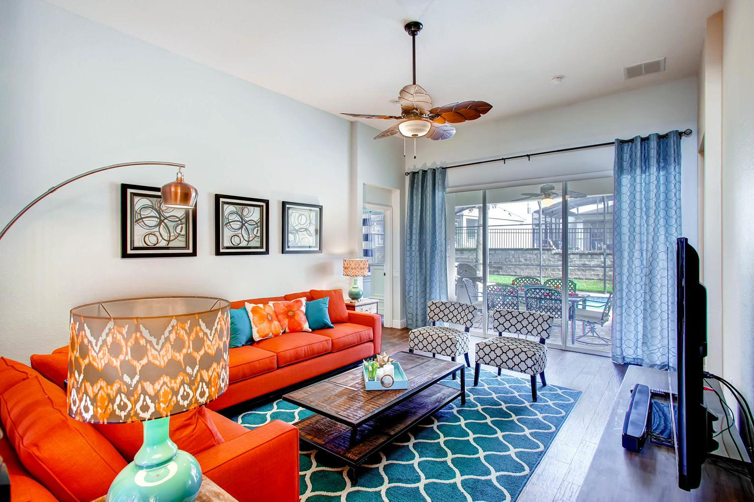 Living area overlooking your very own screened-in private pool & spa.