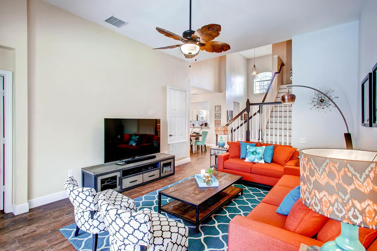 """Spacious living room with tons and seating anf 65"""" 4KTV"""