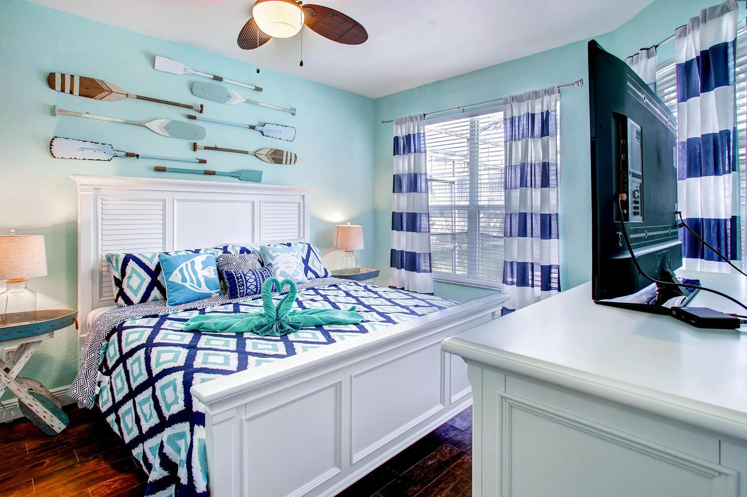 """First floor nautical themed king master bed with plush 12"""" memory foam  mattress & 50"""" 4K TV"""