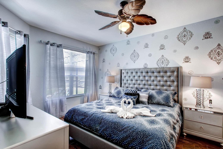 "Master Bedroom 1. King Bed.  First floor. 50"" 4KTV. Overlooks the pool."