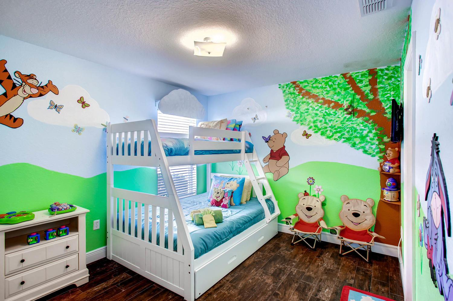 Pooh themed room with bunk bed with trundle that can sleep 4. 32 inch Smart TV.