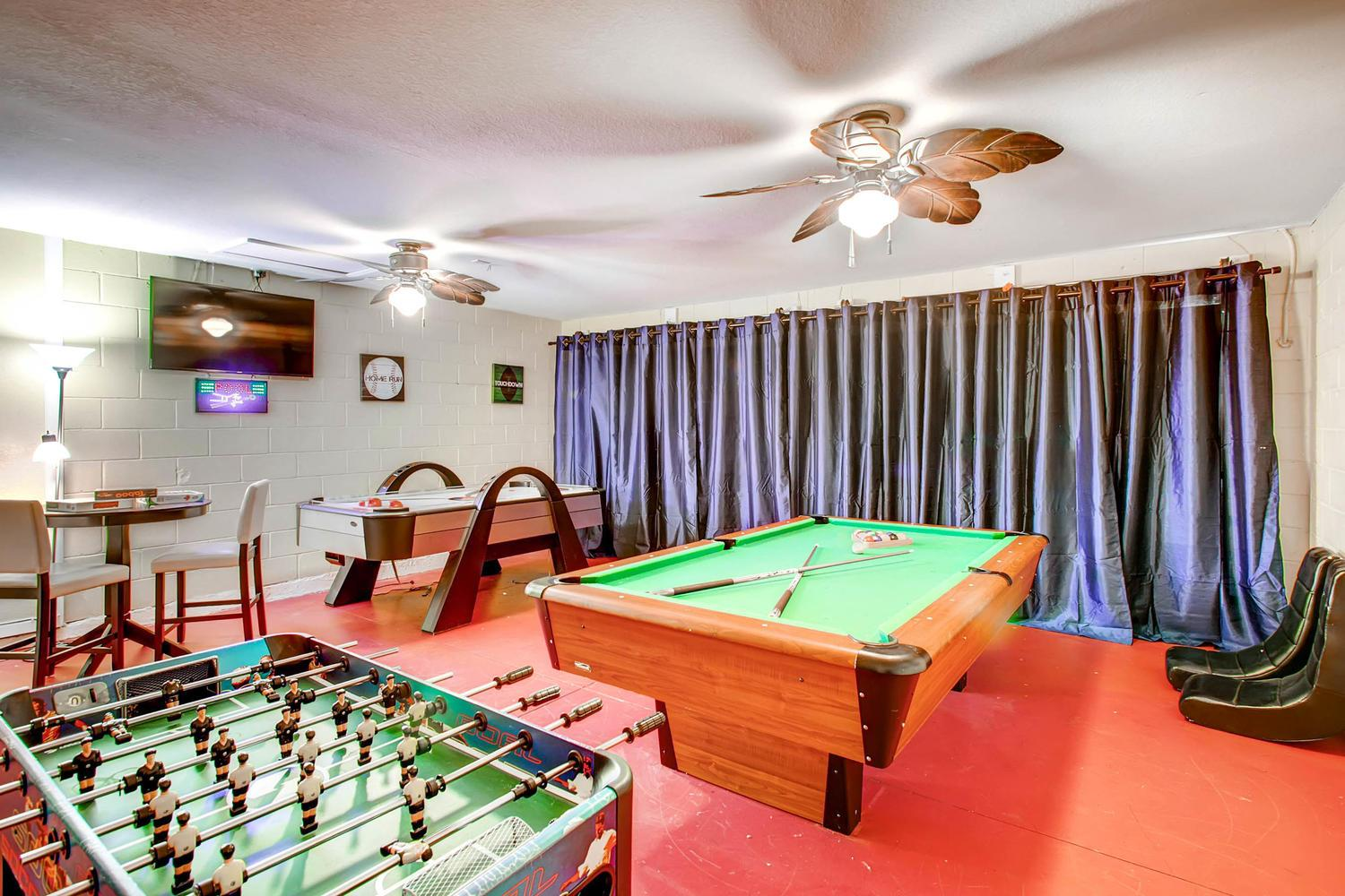 """Game room with billiards,air hockey, foosball,toys, board games,48"""" 4K TV & more"""