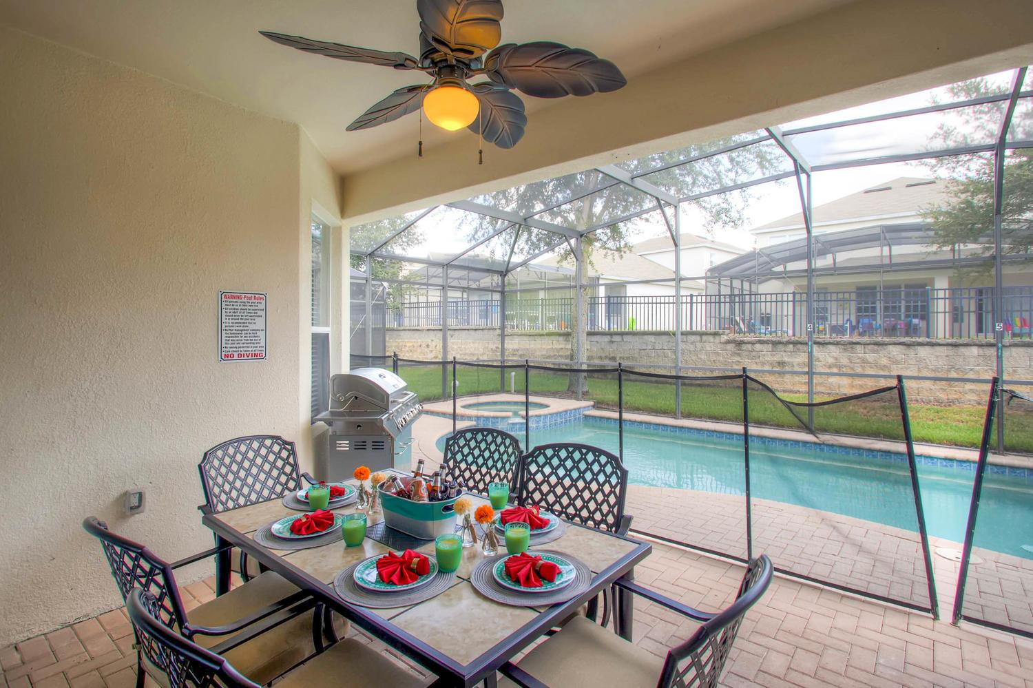 Shaded deck w ceiling fan, upgraded patio dining, grill and child safety fence