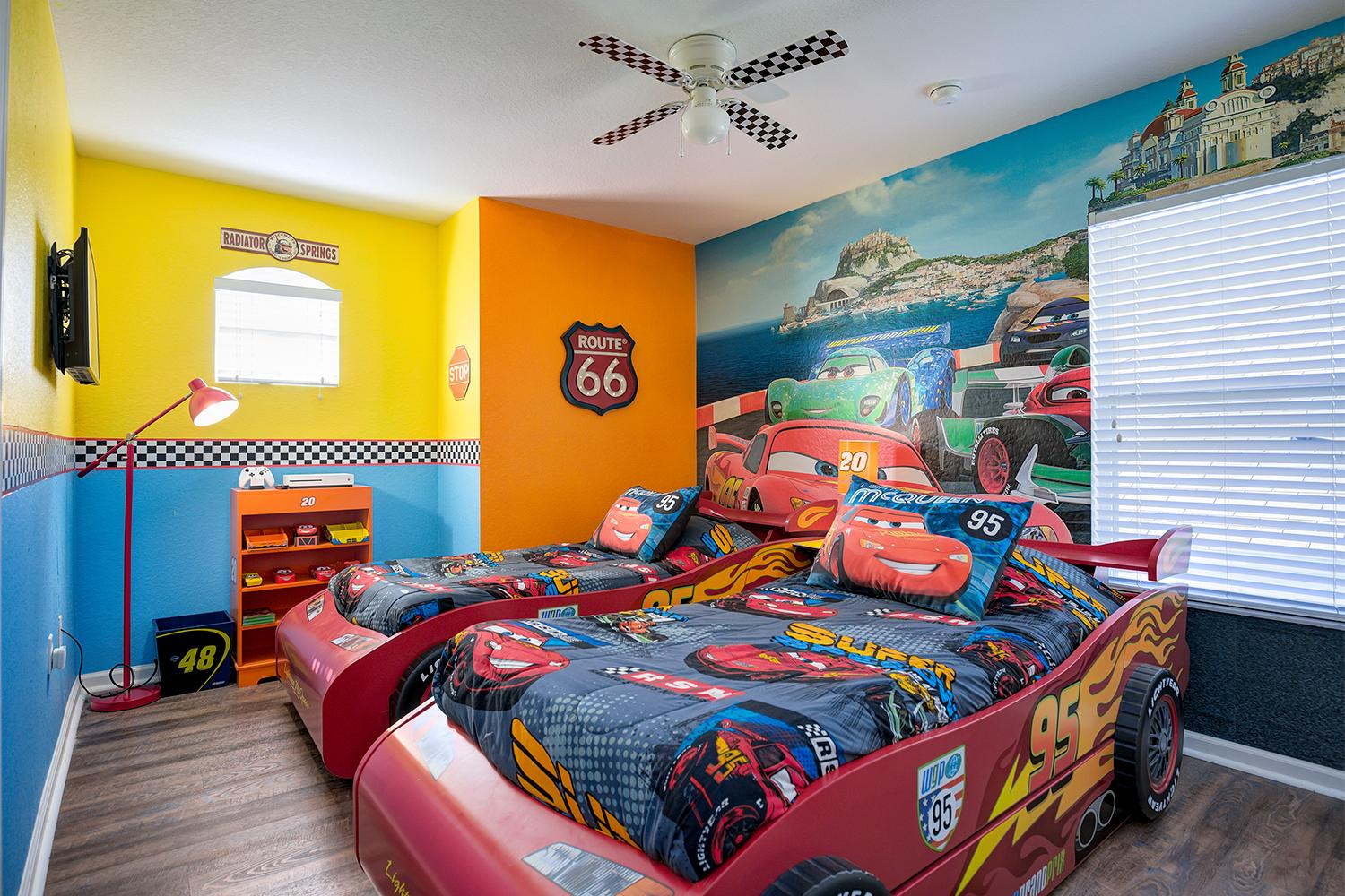 """Disney Cars room with two Lightning McQueen twin beds, XBox One S and 32"""" 4K TV"""