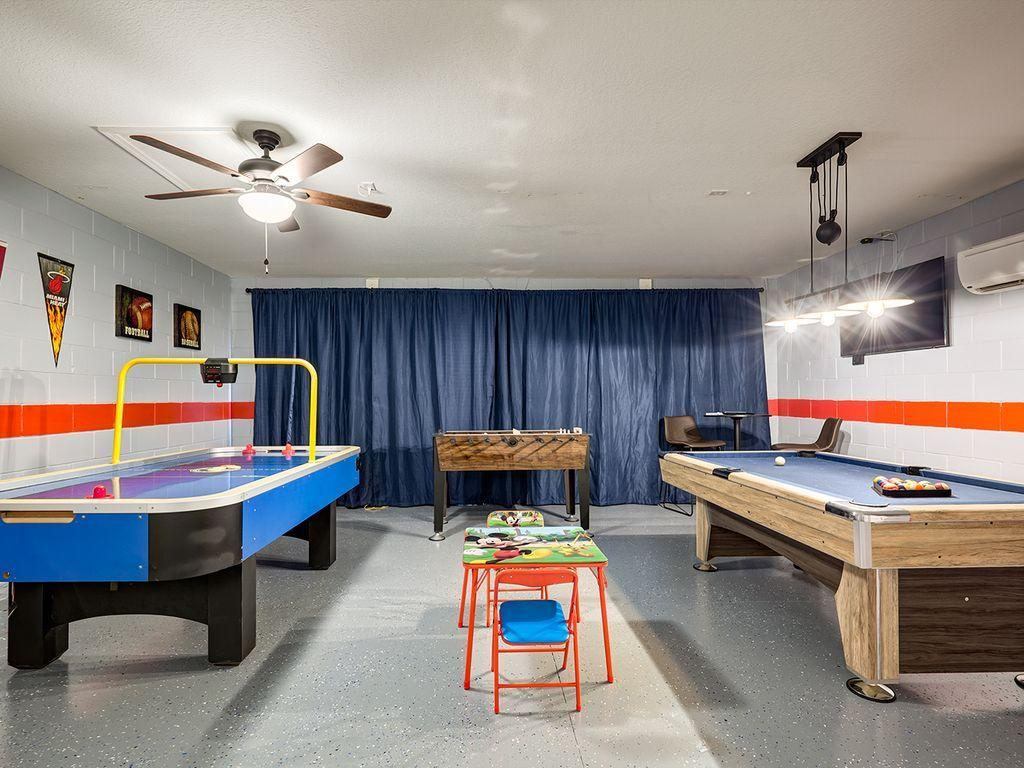 """Air Conditioned Game Room with Billiards, Air Hockey, Foosball, 50"""" 4K TV , Pub seating and  more"""