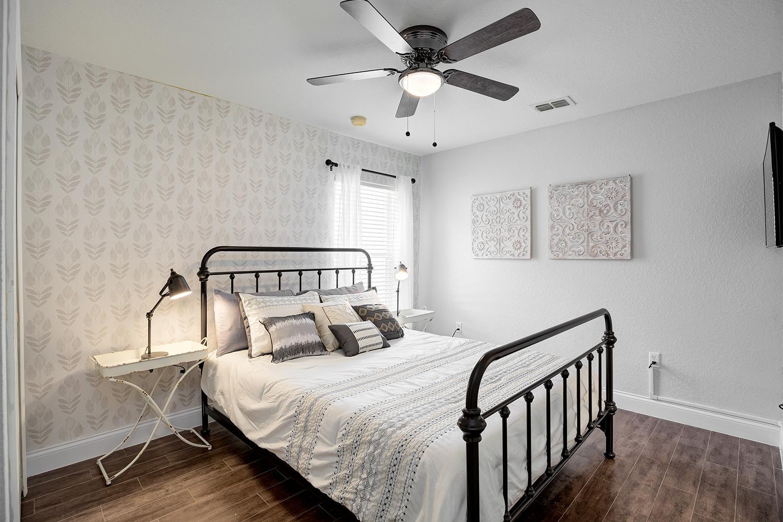 "Farmhouse inspired Queen Bedroom  37"" 4K TV and en-suite full bath."