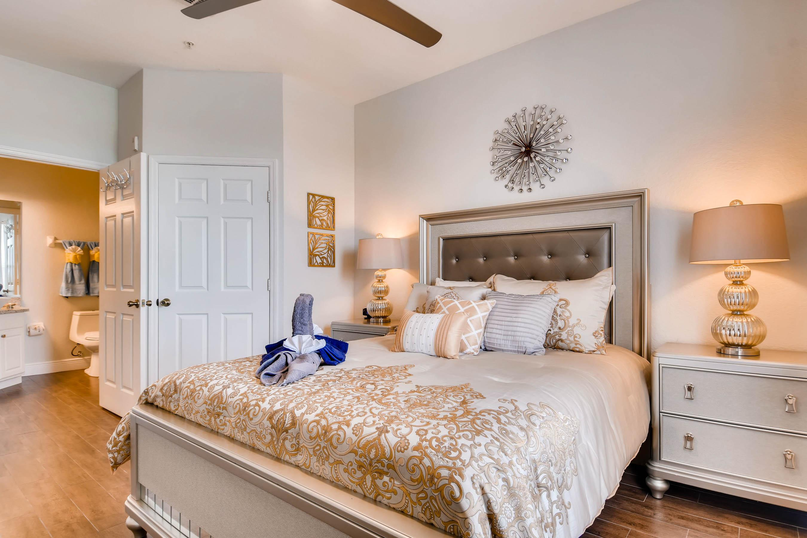 Another view of the master bedroom, ALso seen: walk in closet & en-suite master bath