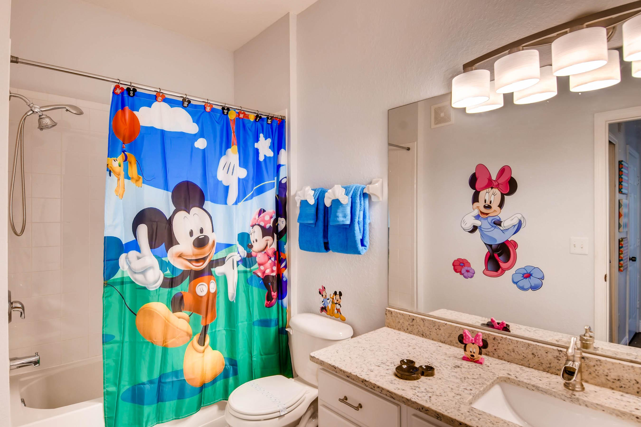 Disney themed full bath with shower/tub combo with hand shower
