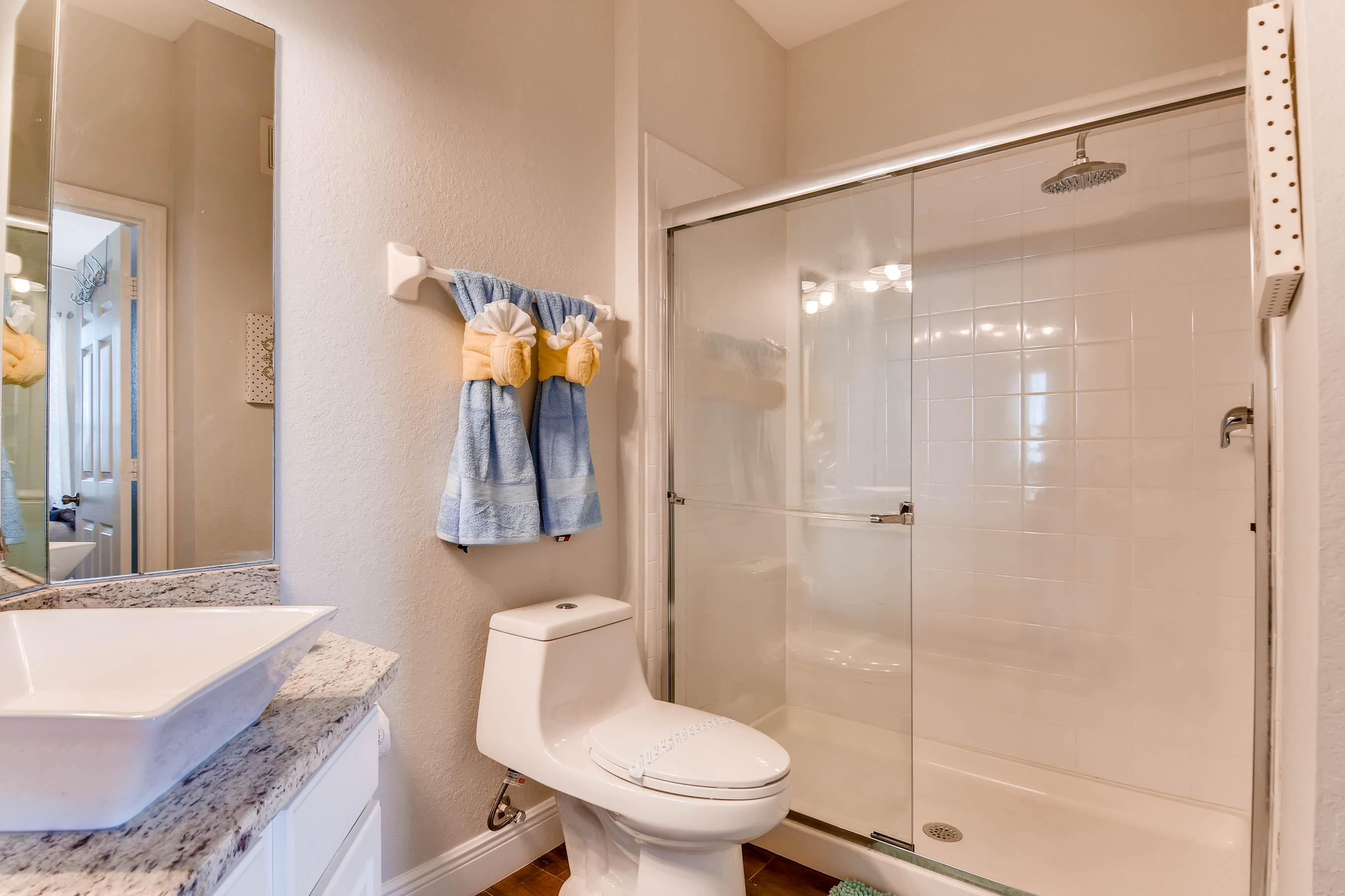 En-suite with upgraded fixtures and walk-in shower with rain shower head