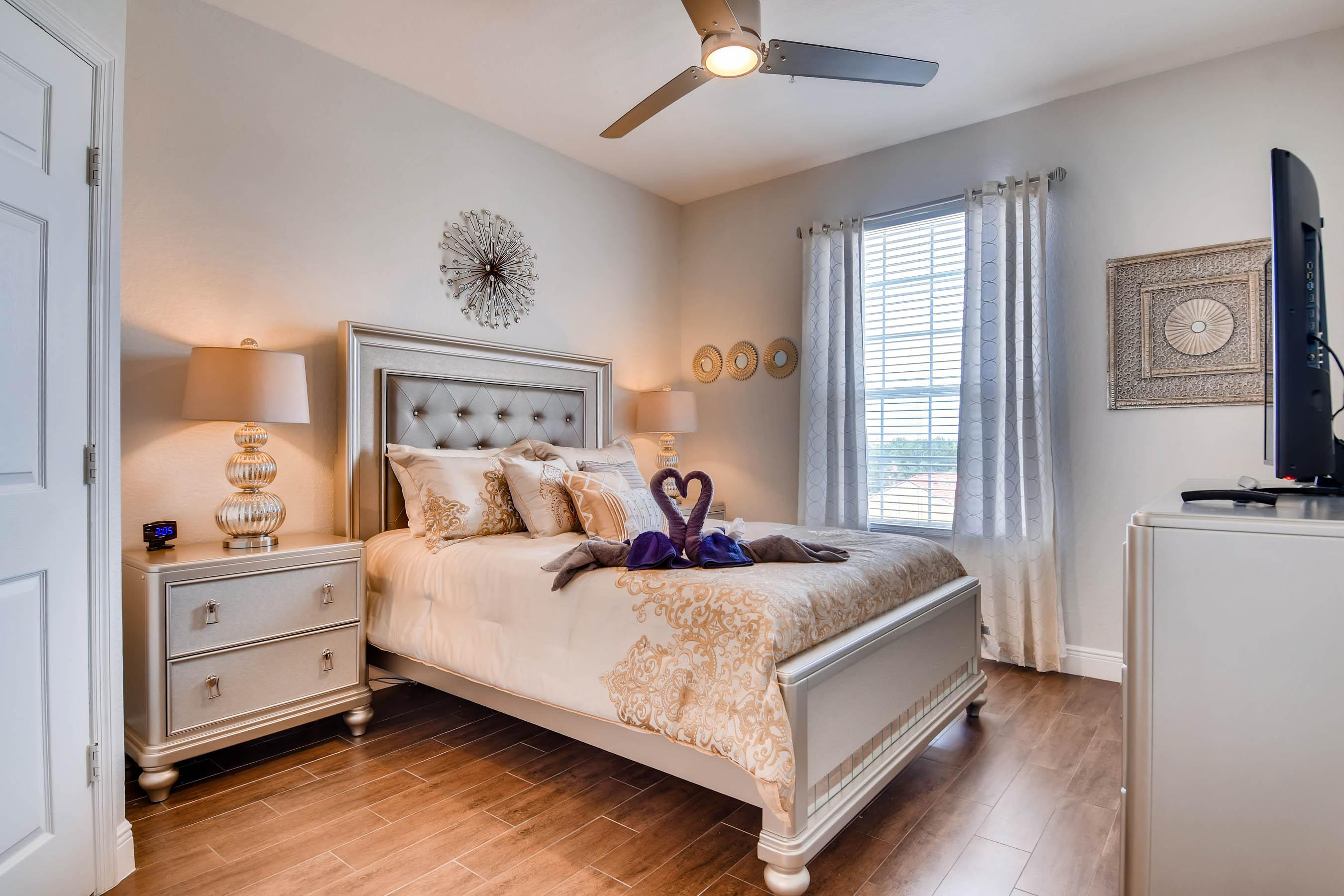"""Queen master bedroom with designer furniture,  plush 12"""" memory foam mattress and 50 inch 4K TV"""