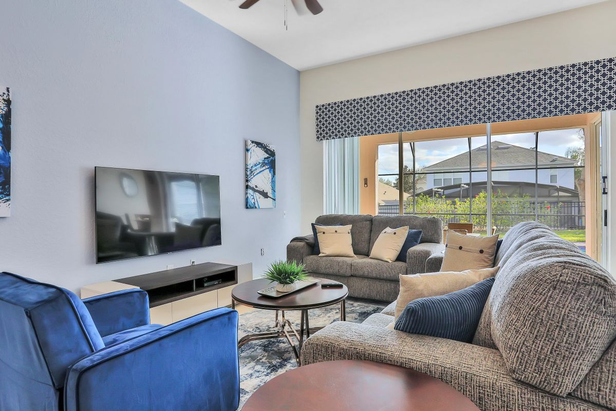 """Comfortable family room with 65"""" TV"""