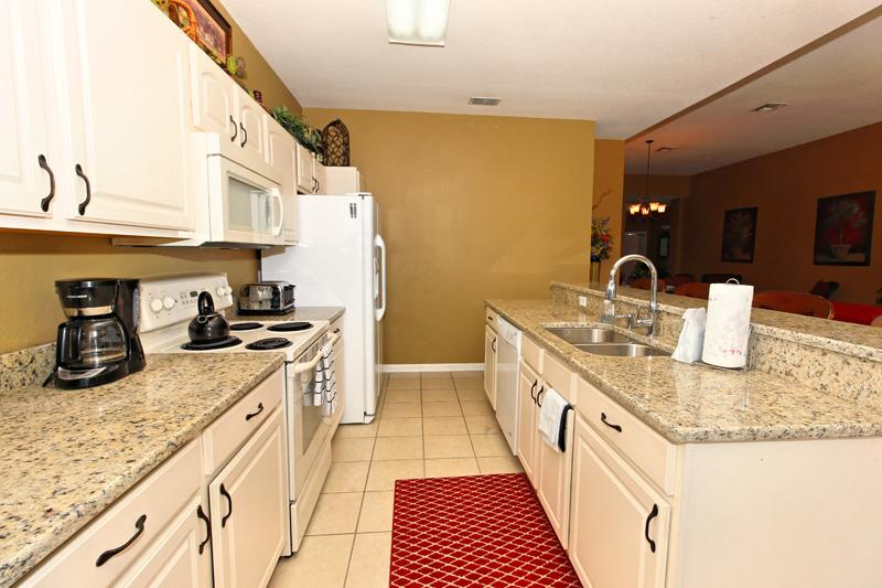 Luxurious granite counter tops with lots of space.